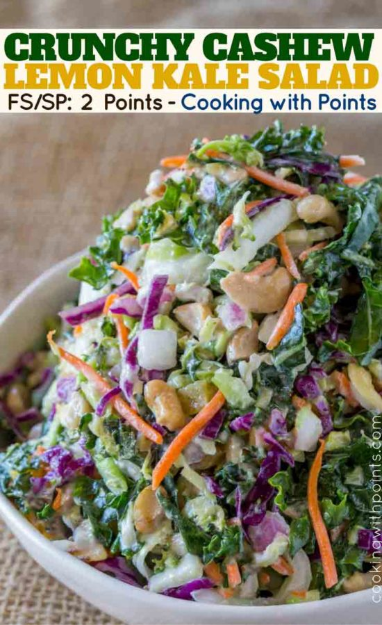 An easy filling delicious crunch and creamy Kale Salad with cashews and a lemon greek yogurt dressing.