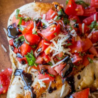 Balsamic Bruschetta Chicken with a fresh tomato, basil, garlic and Parmesan topping with a delicious balsamic glaze. Delicious and easy with just 3 freestyle and 7 points plus points per serving.