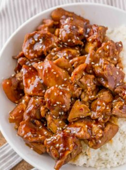 Skinny Sesame Chicken in bowl with rice.