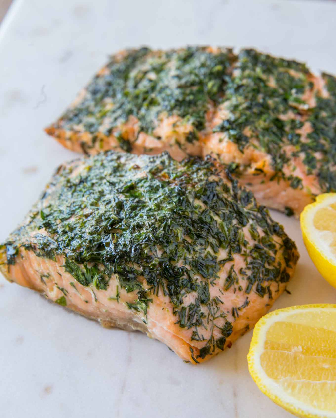 Lemon Dill Salmon on marble board.