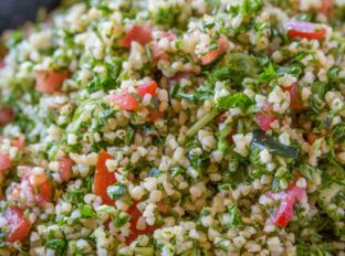 Tabbouleh salad in blue bowl