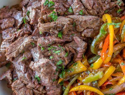 Carne Asada with bell peppers in bowl