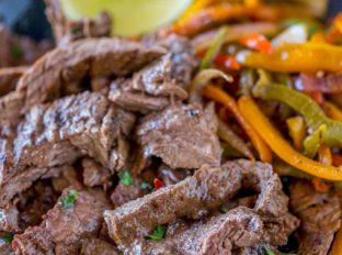 Carne Asada on plate with peppers