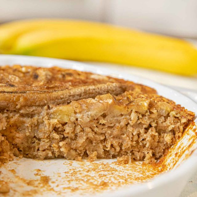 Banana Baked Oatmeal on plate with maple syrup