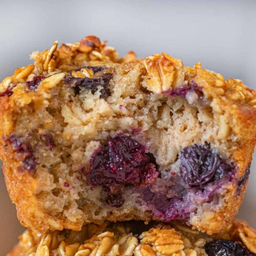 Blueberry Banana Baked Oatmeal Muffins in stack