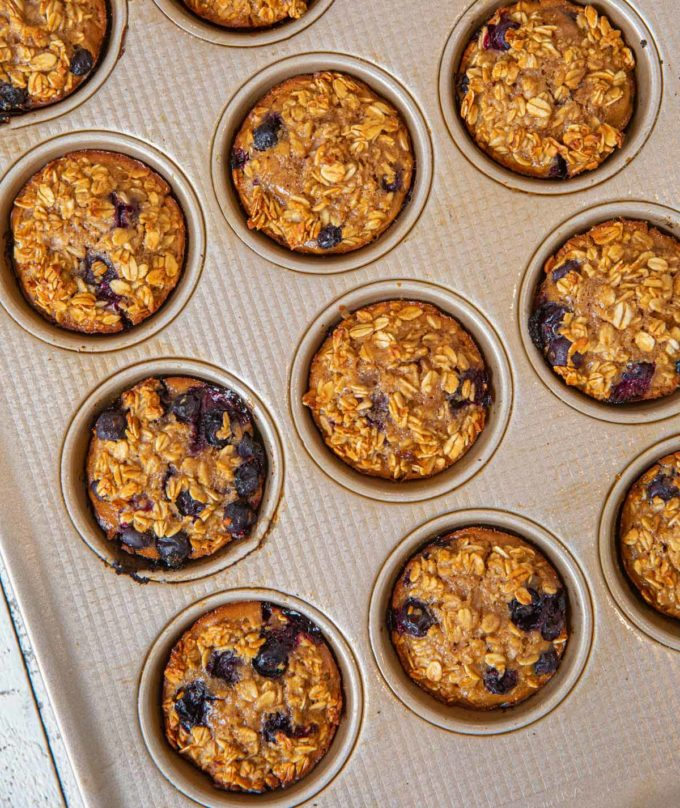 Muffin tin full of Blueberry Banana Baked Oatmeal Muffins