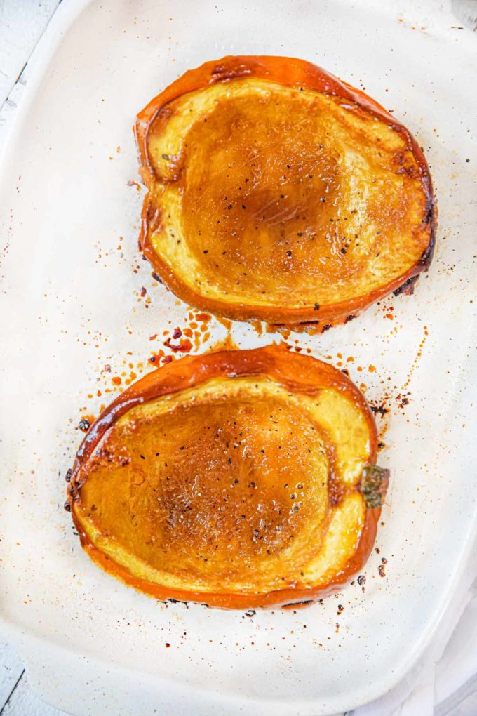 Brown Sugar Acorn Squash two halves on baking dish