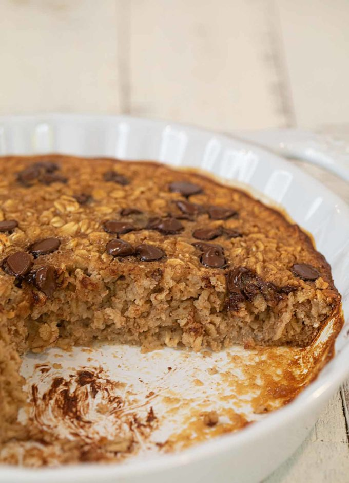 Chocolate Chip Baked Oatmeal in pie plate with slice removed
