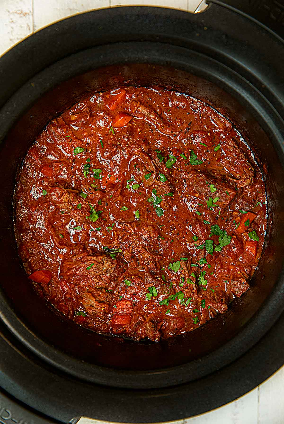 Healthy Beef Ragu in slow cooker after cooking and shredding