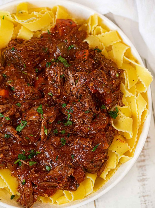 Healthier Beef Ragu over Pasta in white bowl