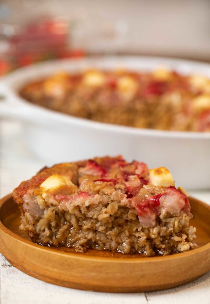 Strawberry Cream Cheese Baked Oatmeal on wooden plate