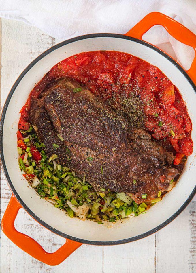 Healthier Italian Pot Roast ingredients in pot before cooking