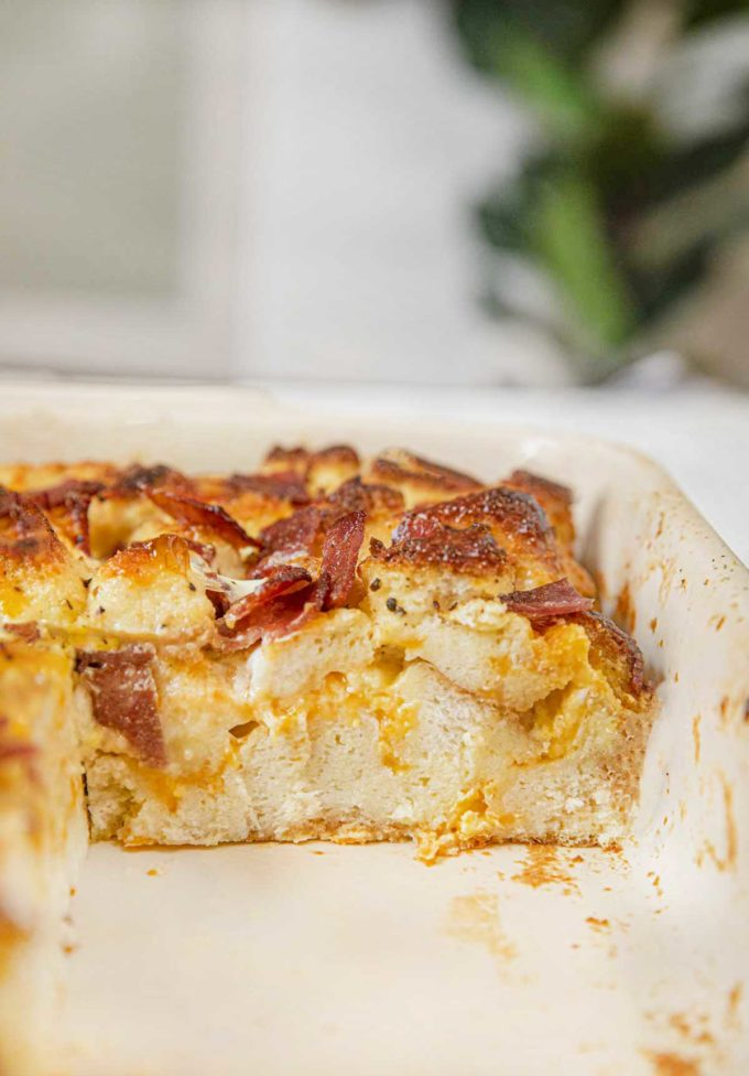 Healthy Breakfast Casserole with Turkey Bacon in baking dish with slice removed