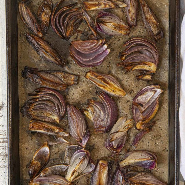 Roasted Red Onions on sheet pan