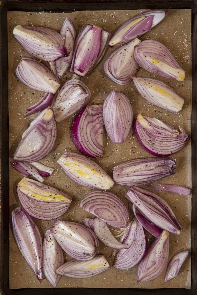 Roasted Red Onions on sheet pan before roasting