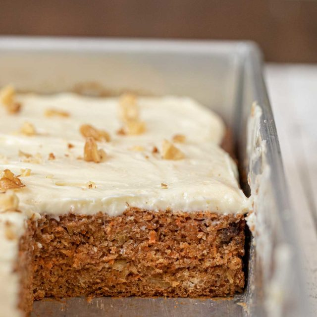 Whole Wheat Carrot Sheet Cake in sheet pan with slice removed