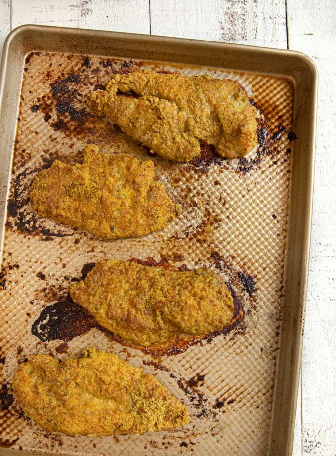 Falafel Crusted Chicken baked chicken breasts on baking sheet