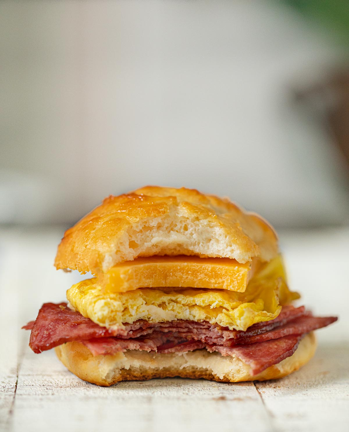 Healthy Bacon and Egg Cheese Biscuit Sandwiches on cutting board