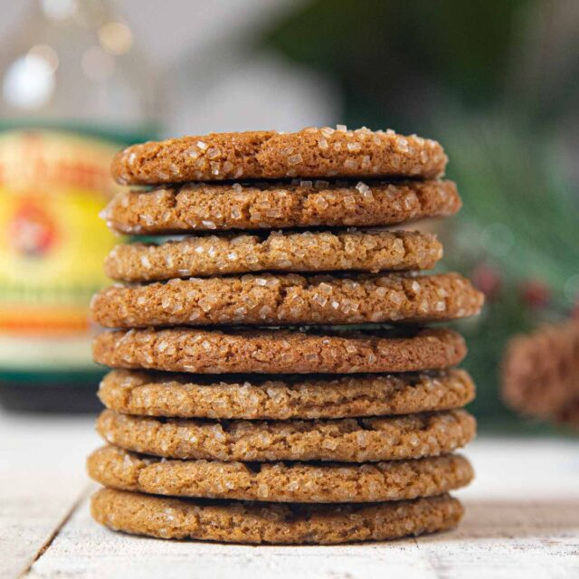 Skinny Ginger Cookies on white wooden table in a stack