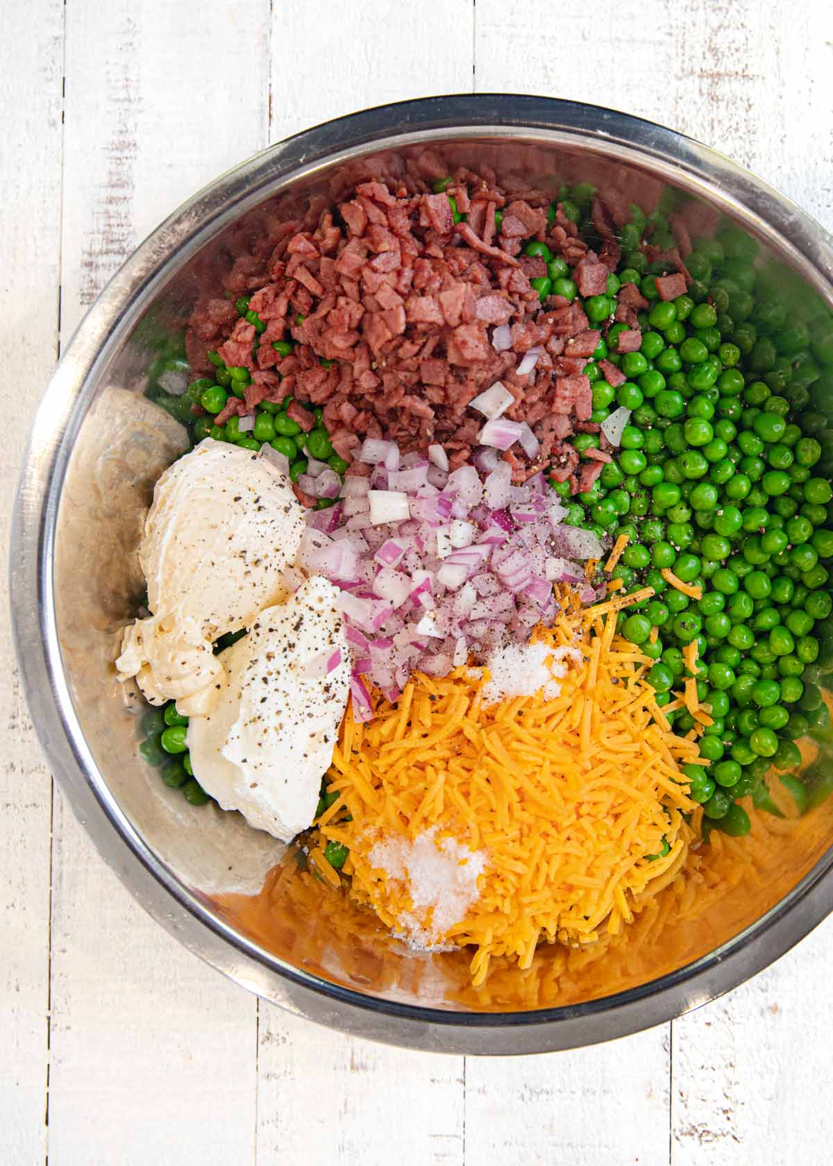 Healthy Pea and Bacon Salad ingredients in bowl