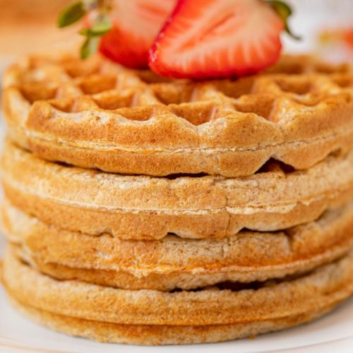 Yogurt Waffles in stack on plate topped with strawberries