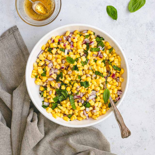 Corn Salad in bowl with spoon and napkin