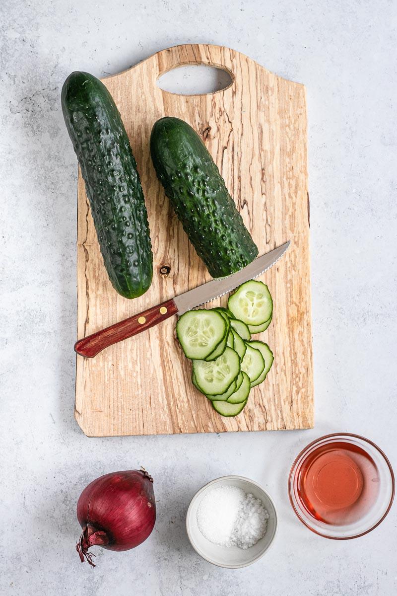 Cucumber Salad cucumbers on cutting board