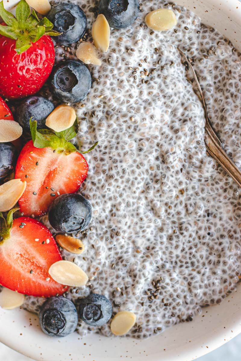 Close up of Vanilla Chai Pudding with berries on top