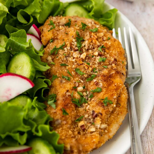 Pecan-Crusted Chicken on plate with salad