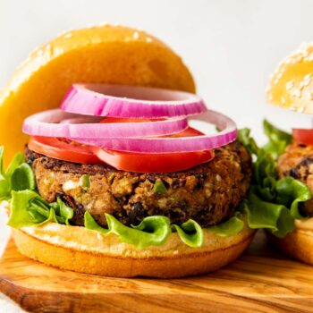 Black Bean Burger on bun with red onion and lettuce