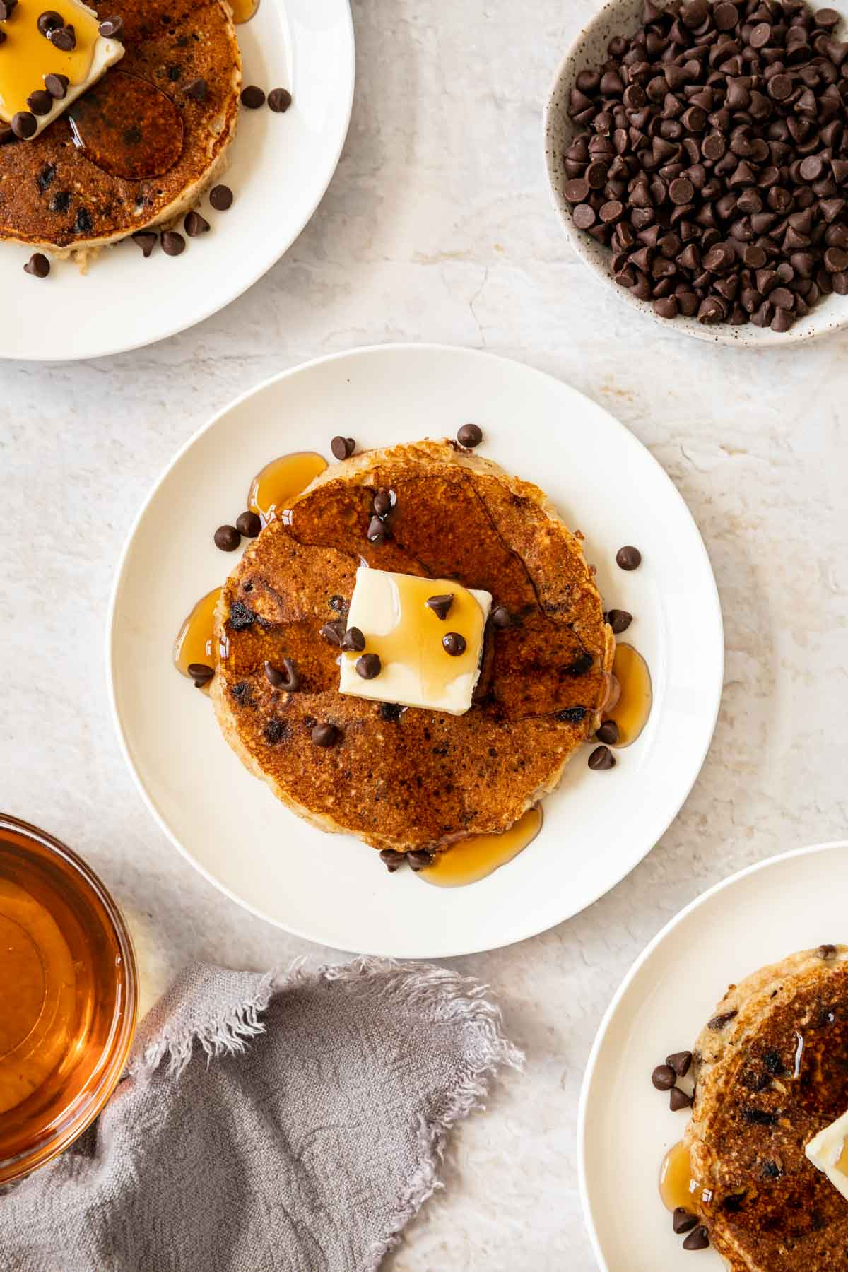 Chocolate Chip Pancakes on plates with bowl of chocolate chips