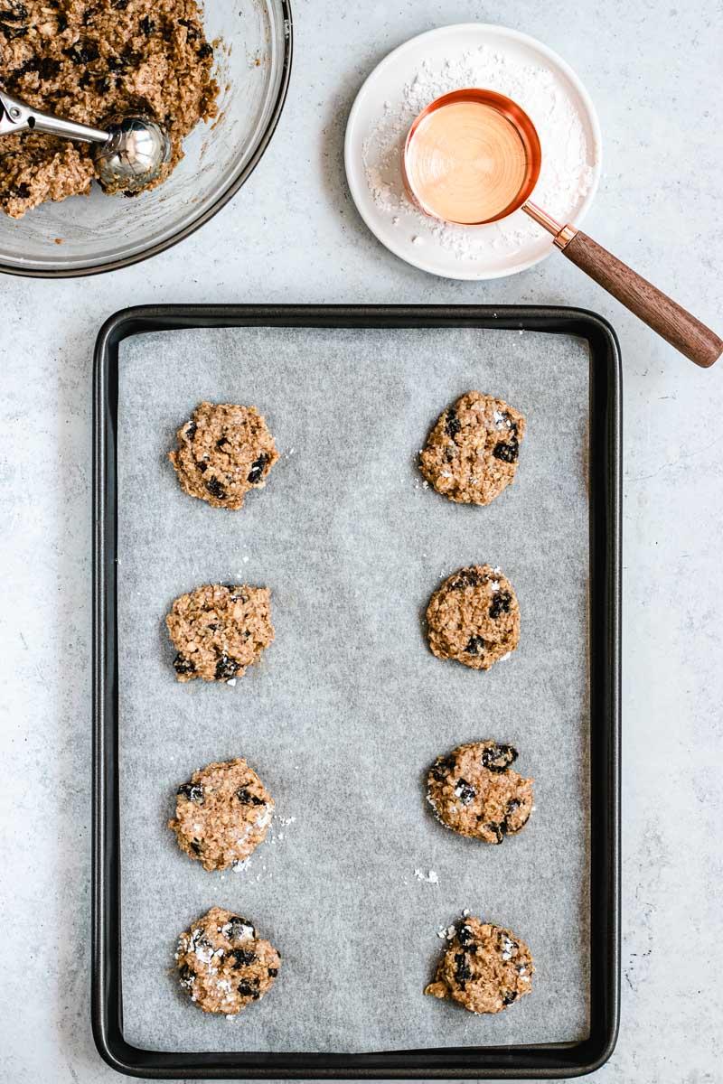Healthy Cinnamon Oatmeal Raisin Cookies flattened unbaked in pan