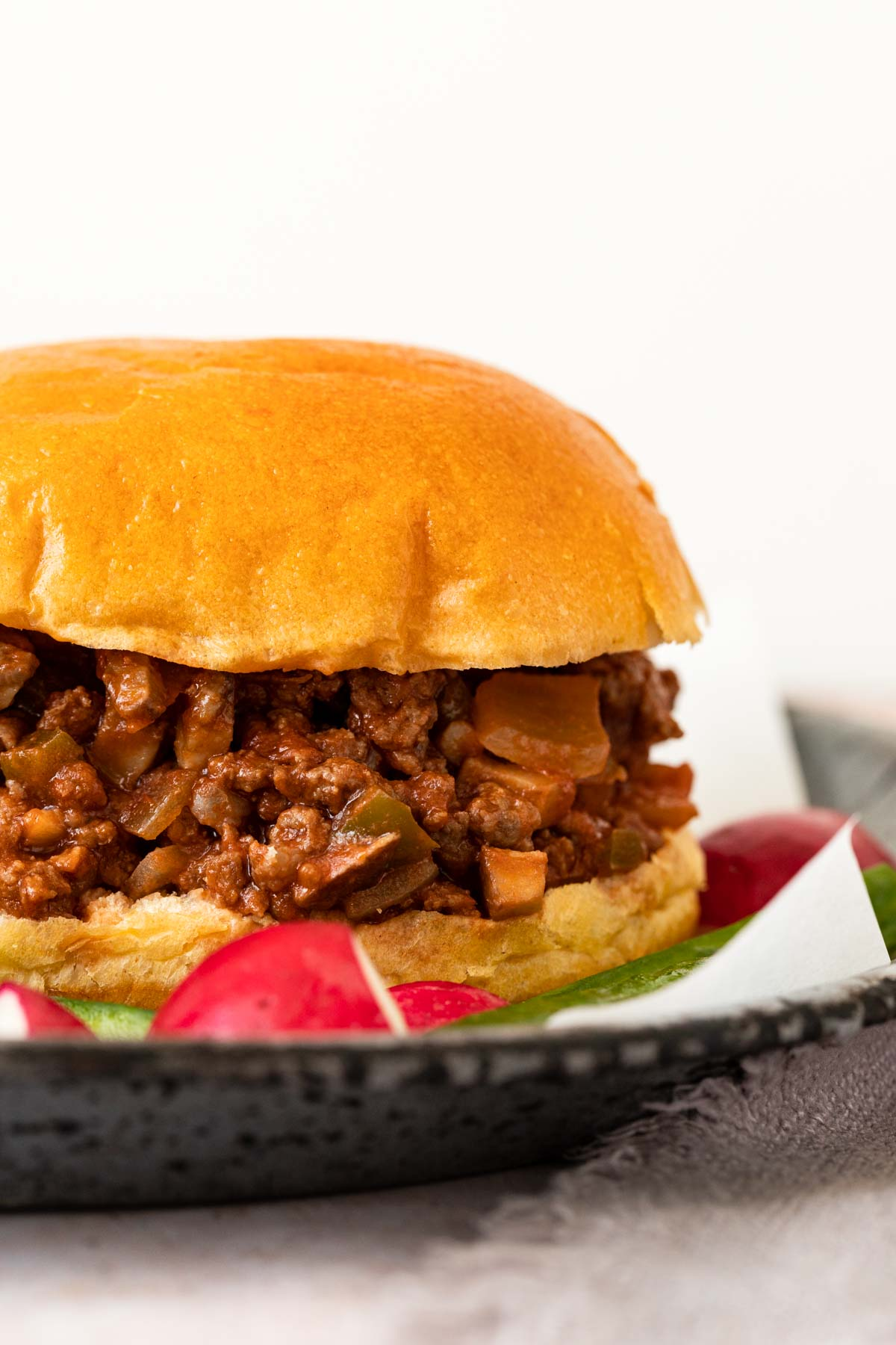Healthy Sloppy Joes closeup on a plate with vegetables