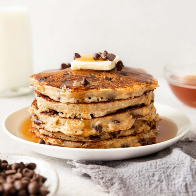 Whole Wheat Chocolate Chip Pancakes on a plate with butter on t