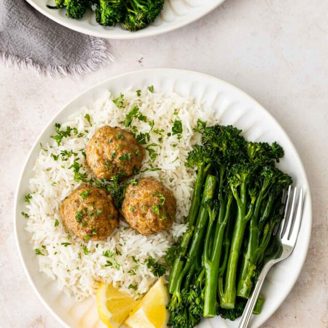 Turkey Meatballs on a plate with rice and brocollini