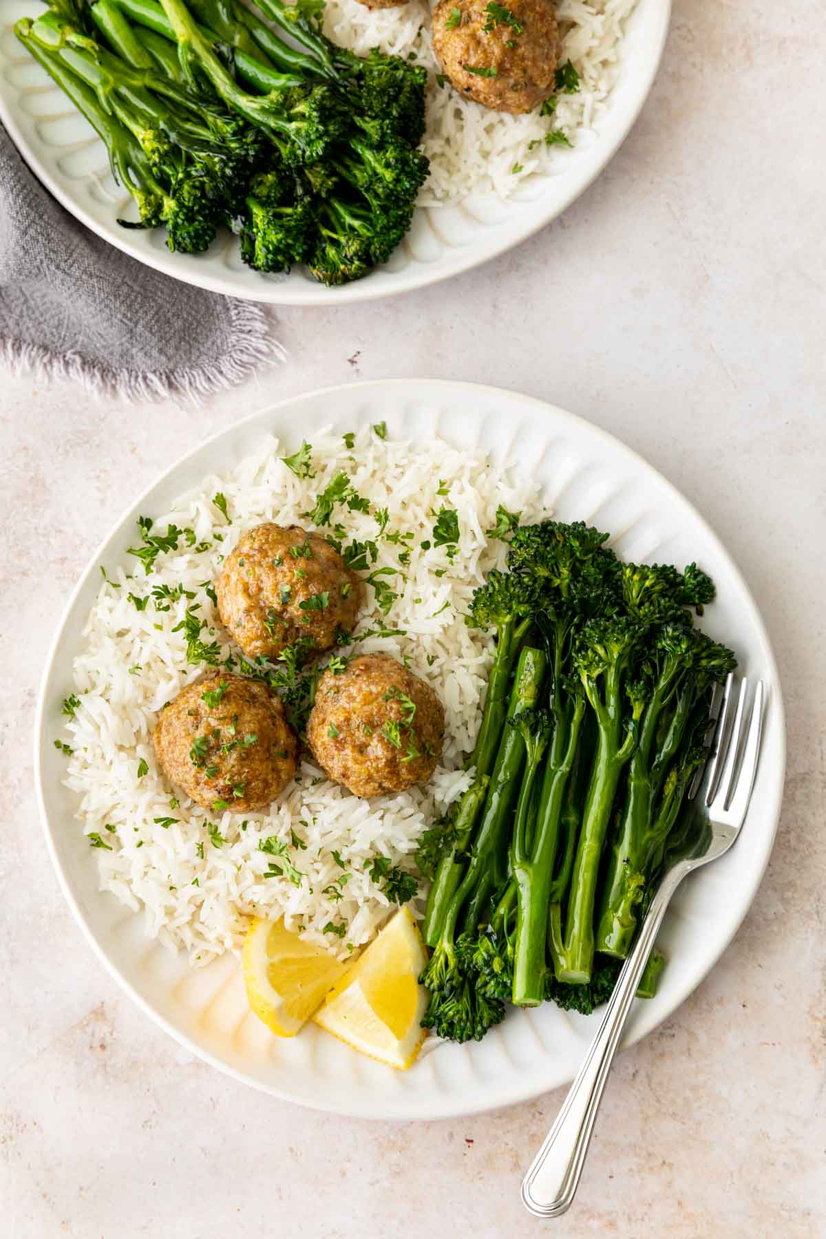 Turkey Meatballs on a plate served with rice and broccolini